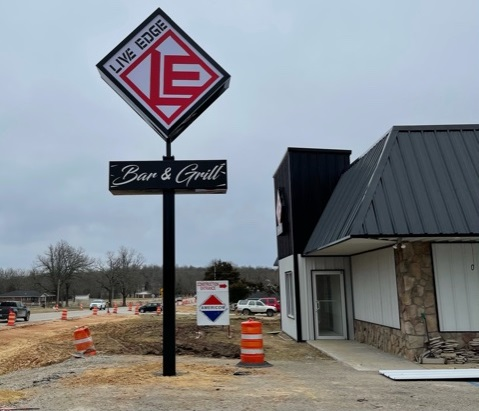 live edge sign next to store