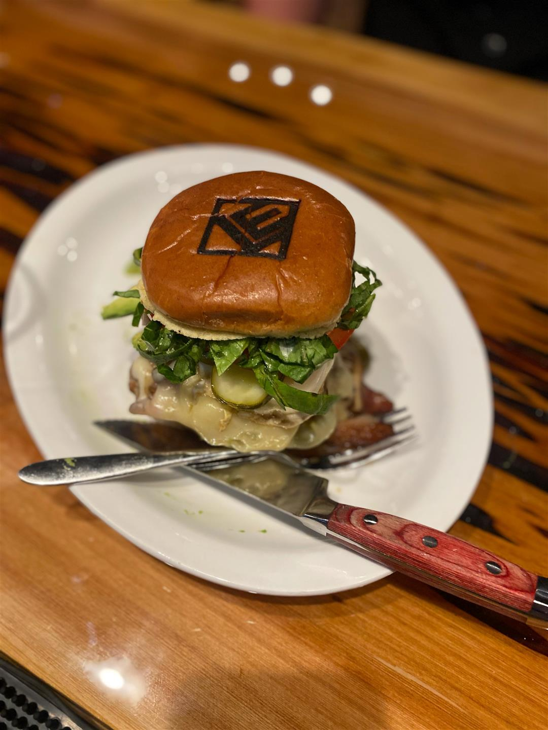 burger with cheese greens and pickles