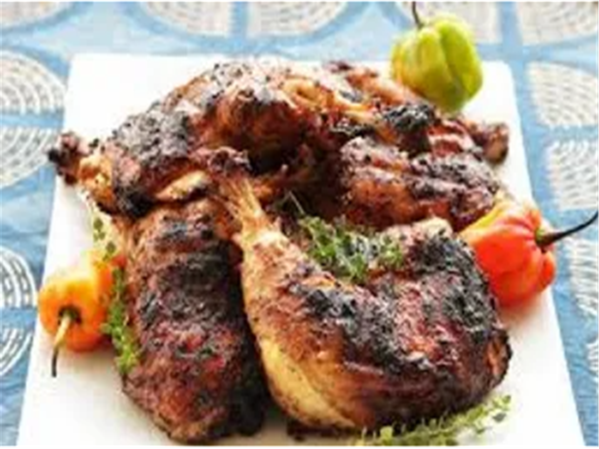 jerk chicken: slowly cooked to perfection served with rice and beans