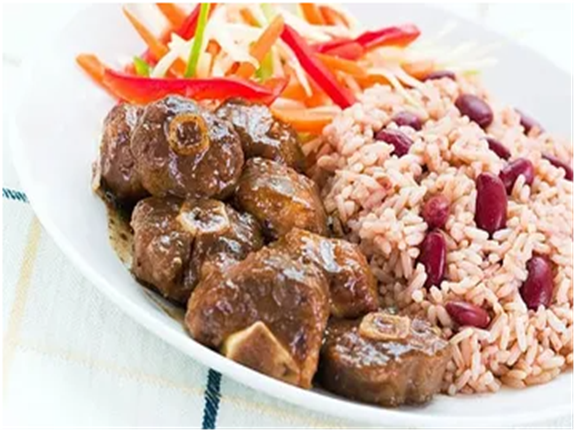 oxtail with rice, vegetables and beans