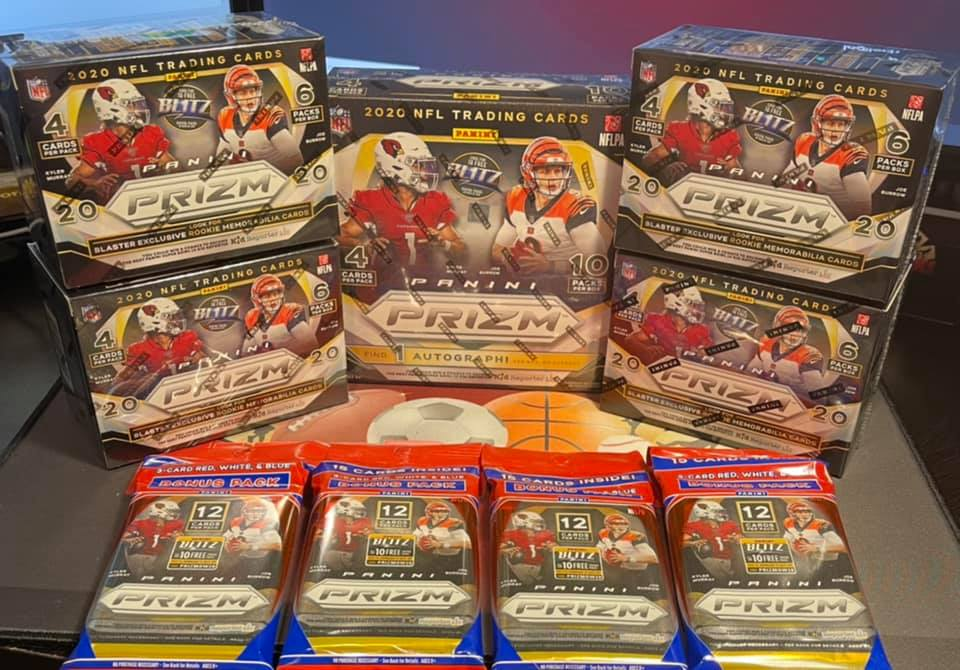 assorted sports cards in a display case