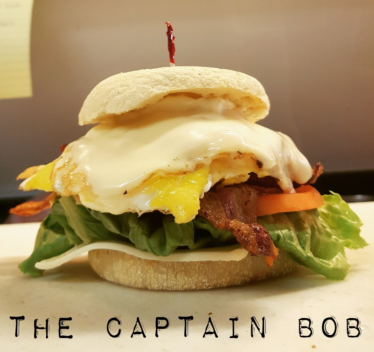 Captain Bob Sandwich: Our classic BLT served on an English muffin topped with two over-hard eggs and melted American cheese