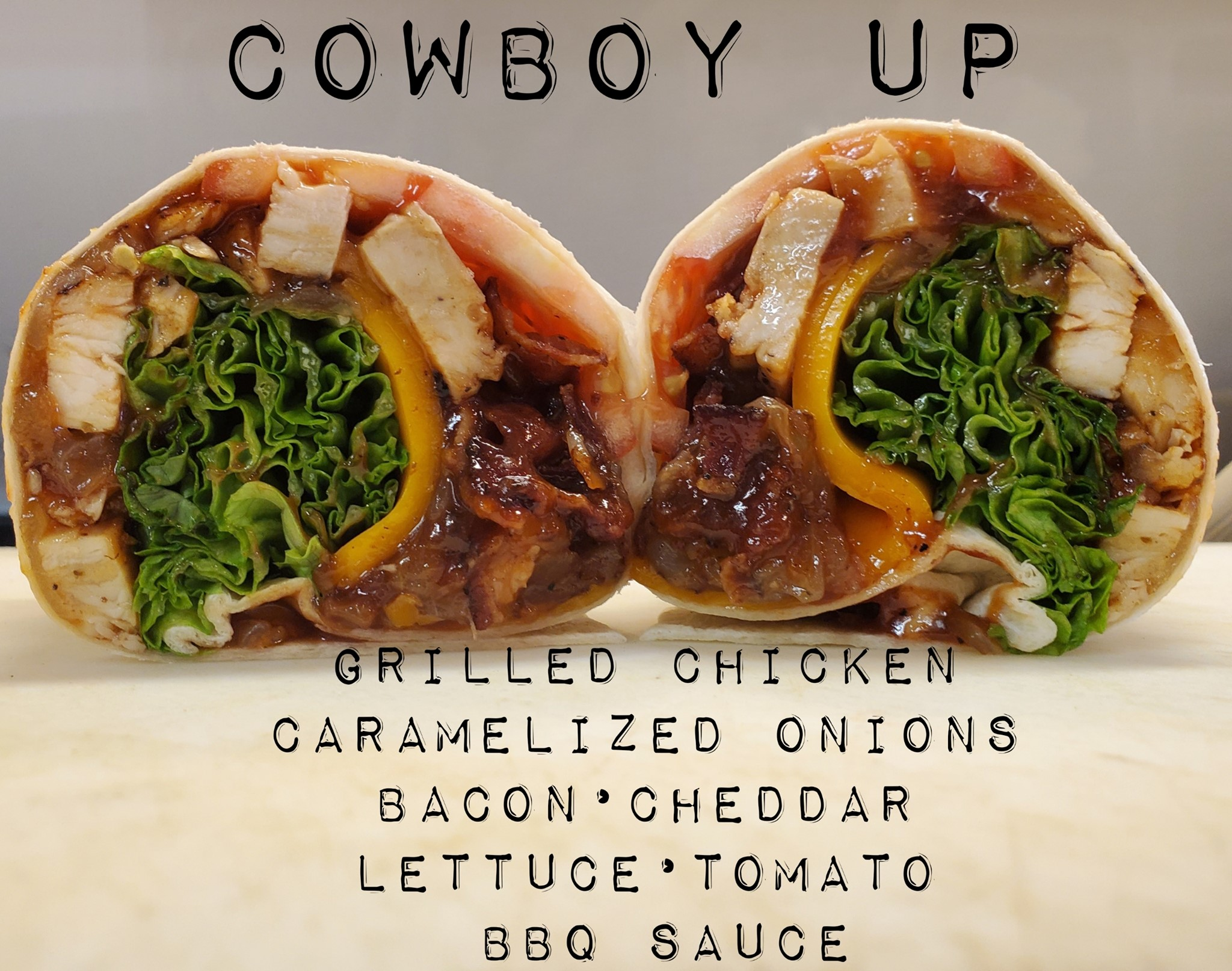 Cowboy up: grilled chicken, caramelized onions, bacon, cheddar, lettuce, tomato, BBQ sauce