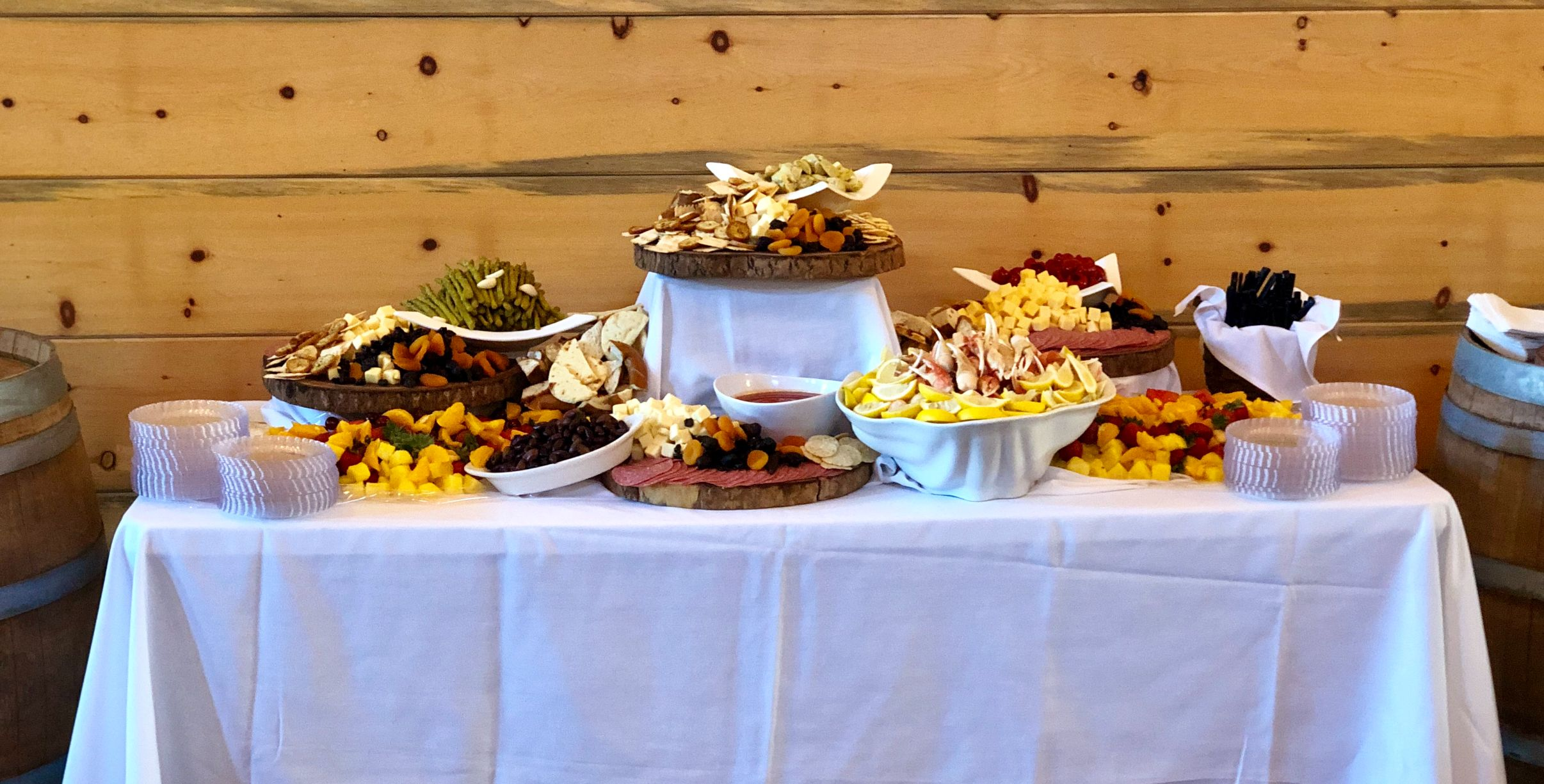 table setup for a party with assorted foods