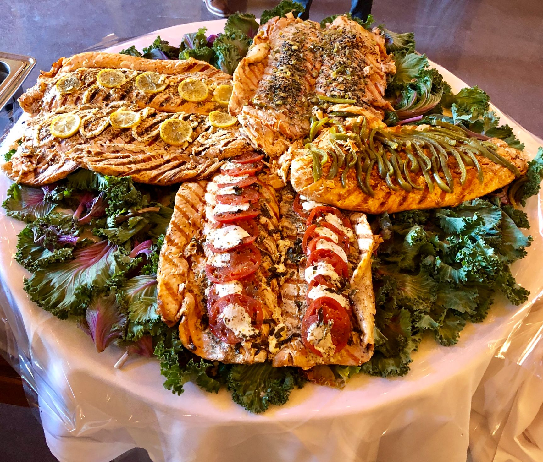 large platter of salmon setup for a party