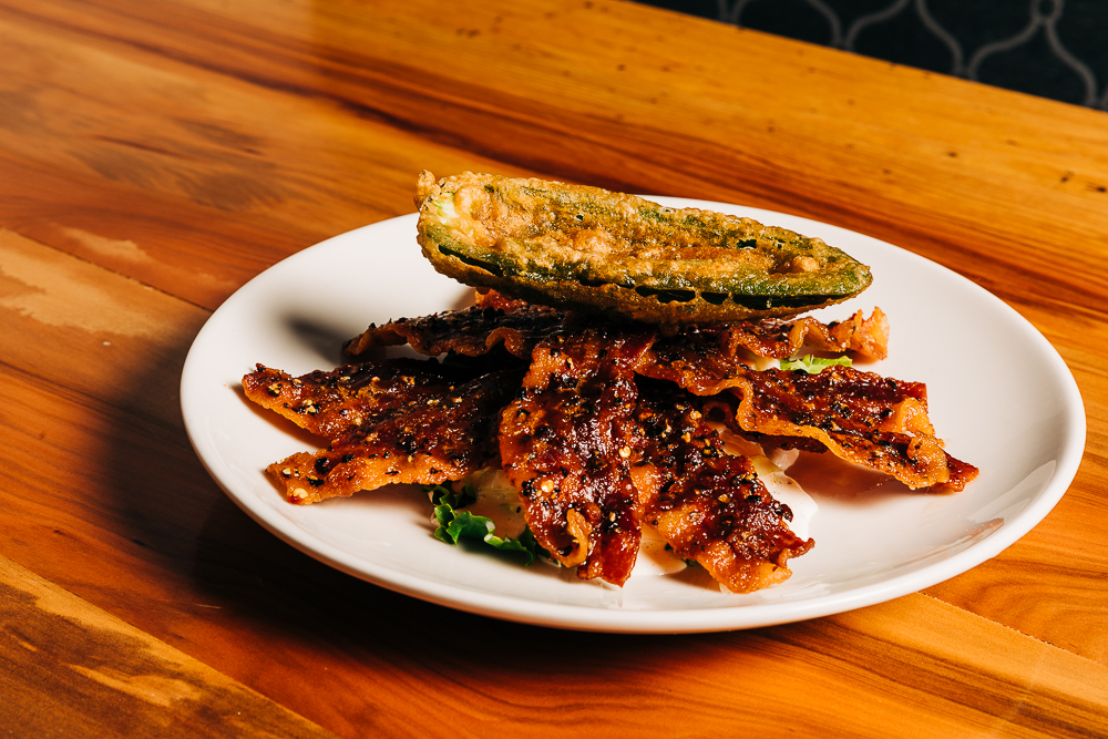Spicy Candied Bacon topped with a fried jalapeno
