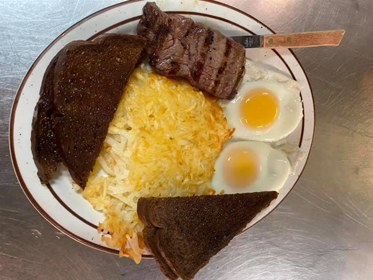 steak and eggs with rye toast and hashbrowns