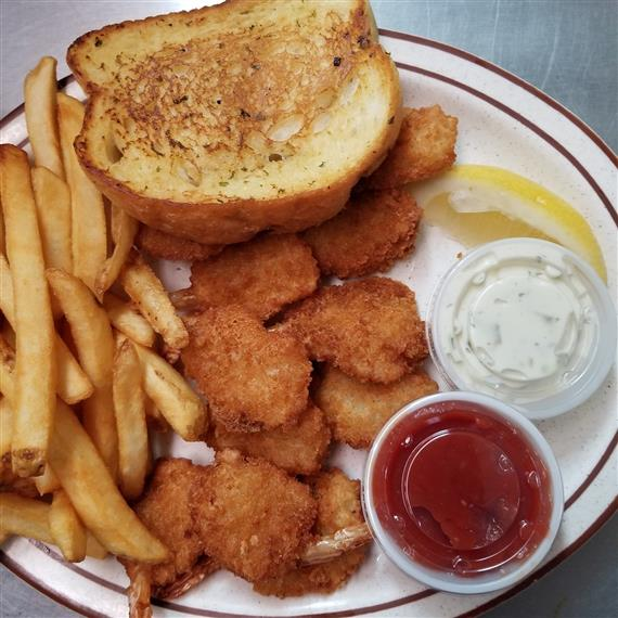 popcorn shrimp on a plate with french fries and texas toast, ketchup and tartar sauce
