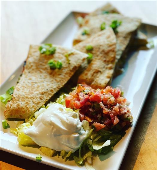 quesadillas with lettuce, salsa and sour cream