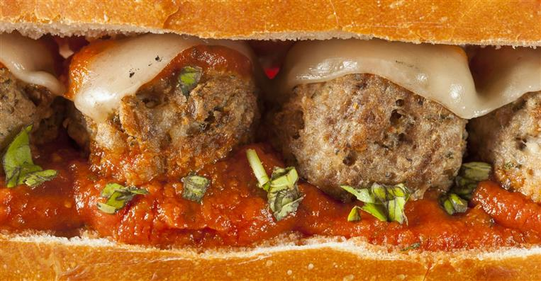 close up of a meatball hero