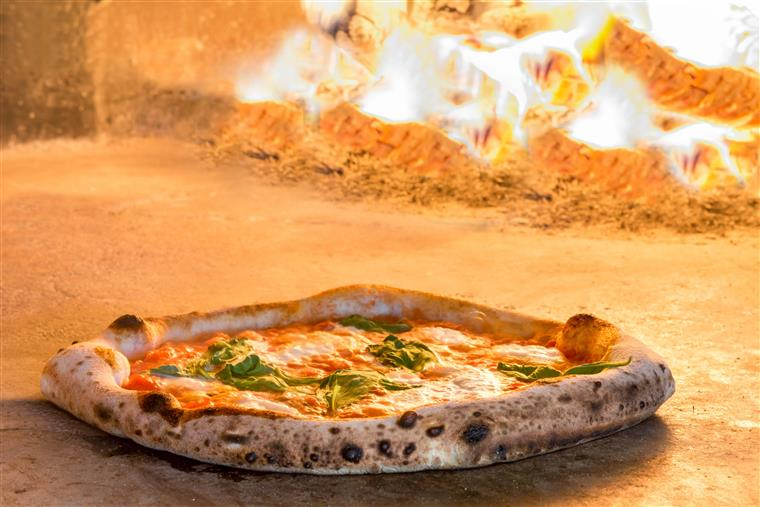 margherita pizza in a woodfire oven