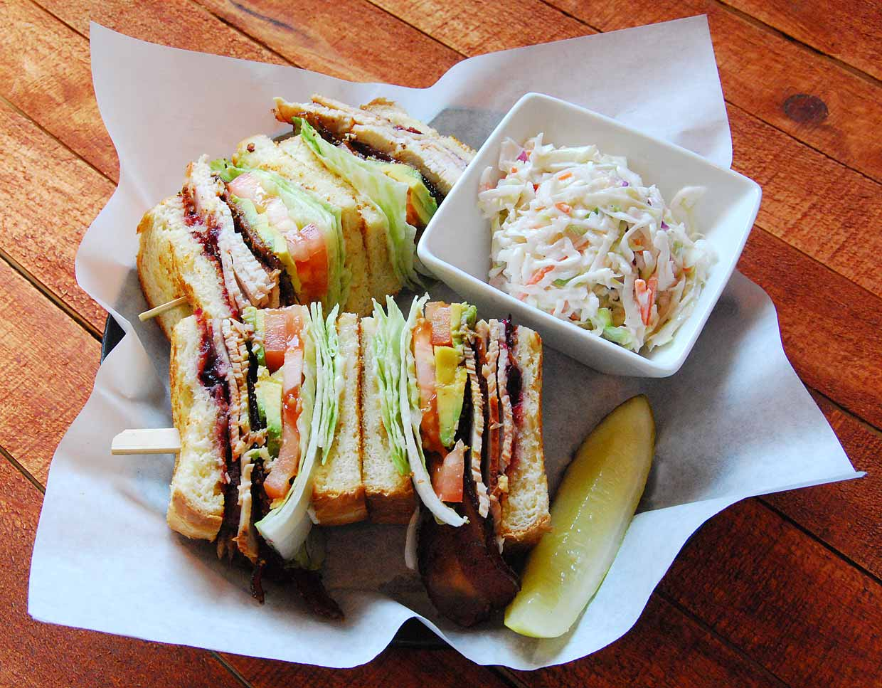 club sandwich with a side of coleslaw