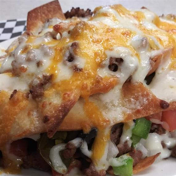beef nachos with various toppings