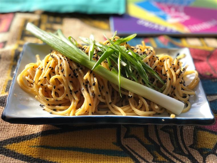 sesame noodles garnished with green onion