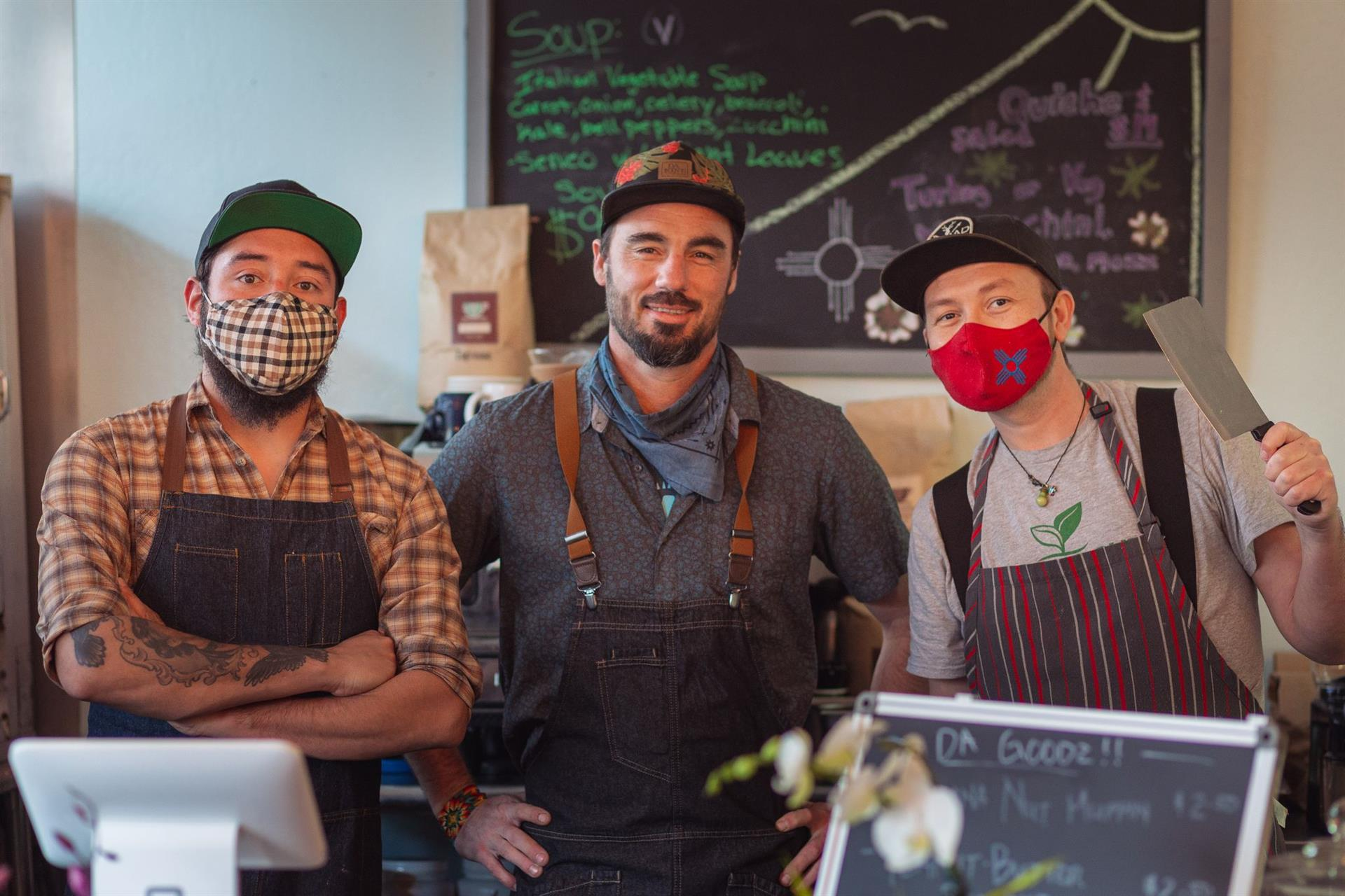 Three staff workers wearing masks