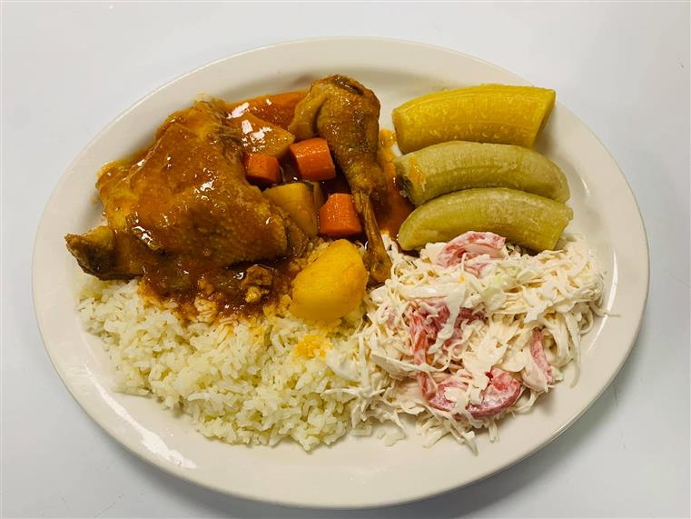 plate of chicken, slaw and fried plantains