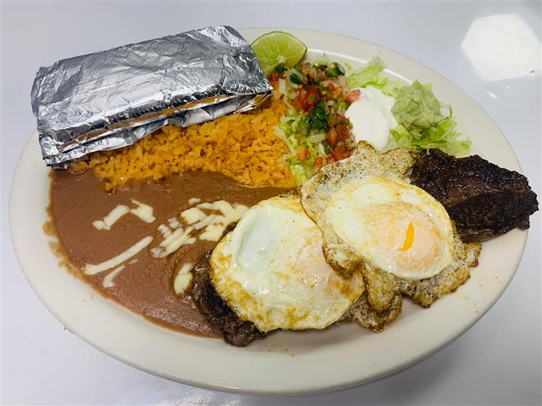 meal with fried eggs, rice, beans and other sides