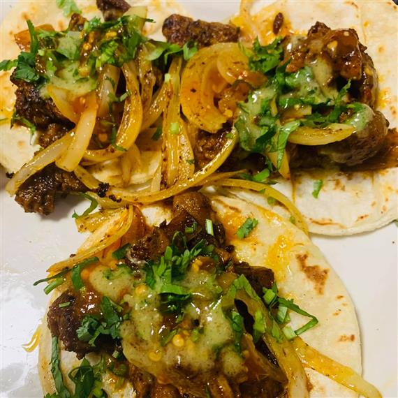 beef tacos with cheese and other toppings