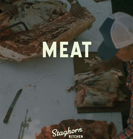 """""""meat"""": man cutting up meat on a cutting board"""