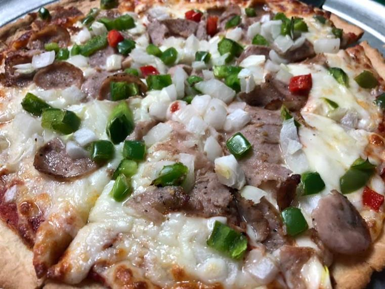 pizza pie with assorted toppings