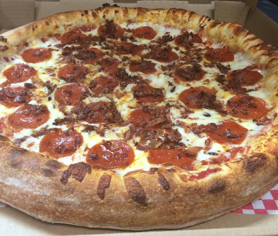 pizza topped with pepperoni and bacon