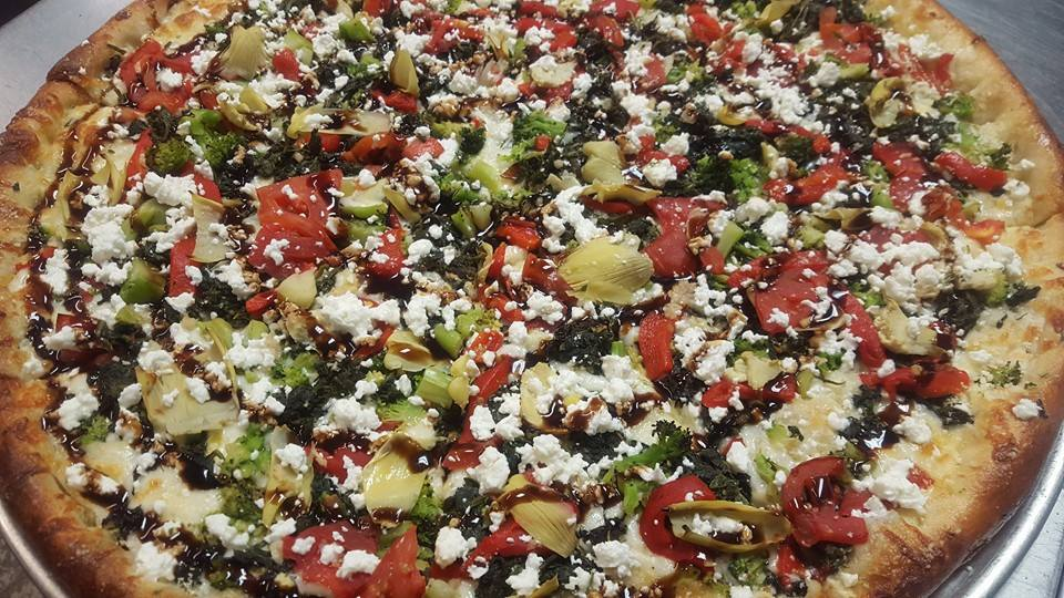 Pizza a la Mickel: Onions, Green Peppers, Artichoke Hearts, Black Olives, Butter Garlic Base topped with Fresh Tomatoes in Balsalmic Vinaigrette & Feta Cheese