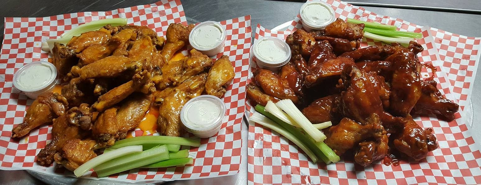 basket of buffalo wings and a basket of barbecue wings
