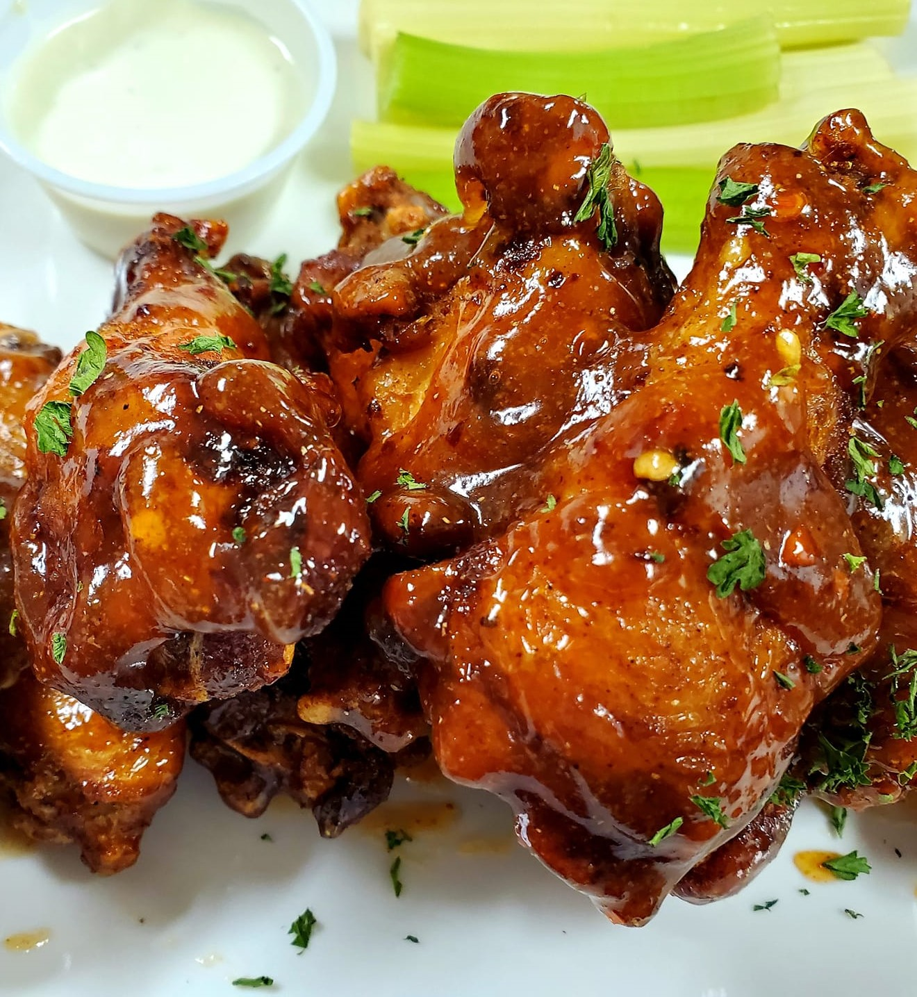 assortment of chicken wings topped with garnish