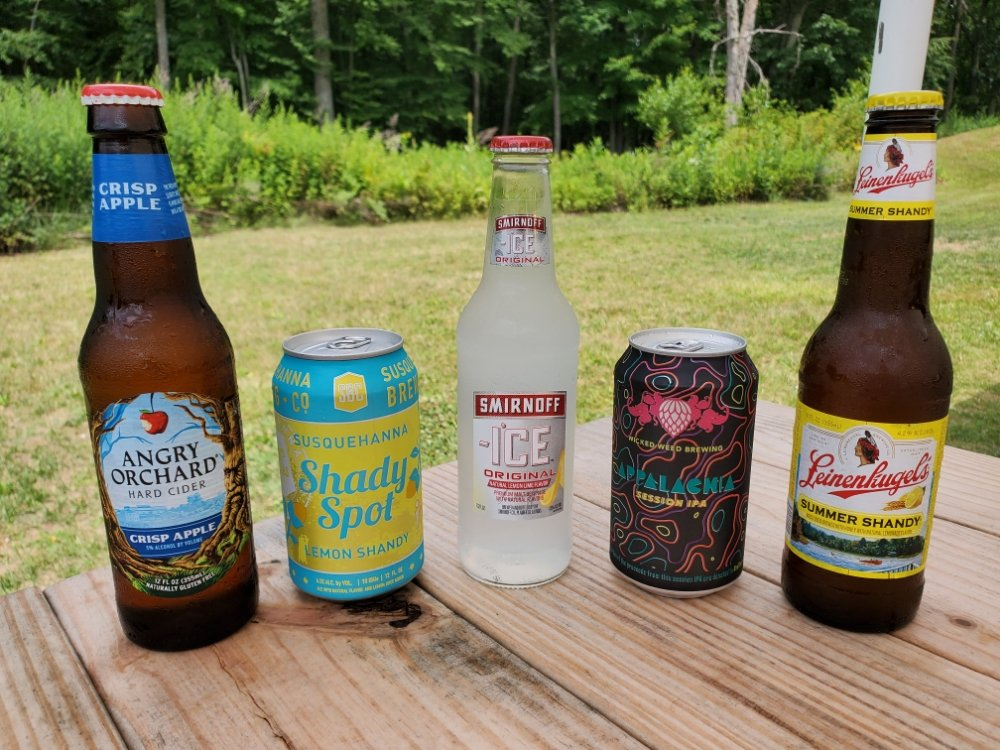assortment of beer bottles and cans