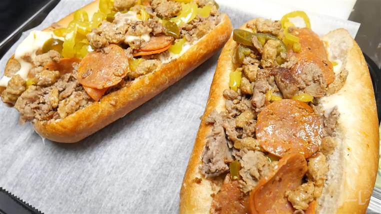 subs topped with phiily steak, pepperoni, banana peppers and onions