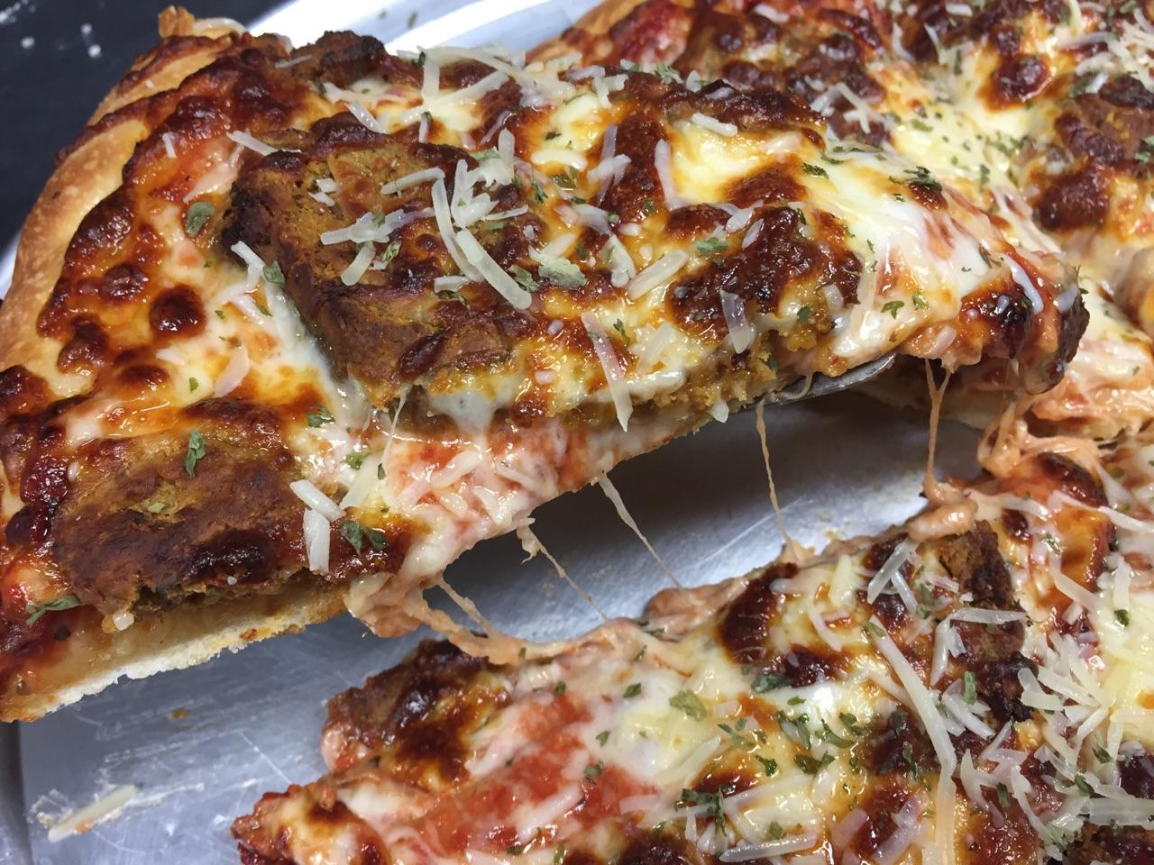 pizza topped with meatball