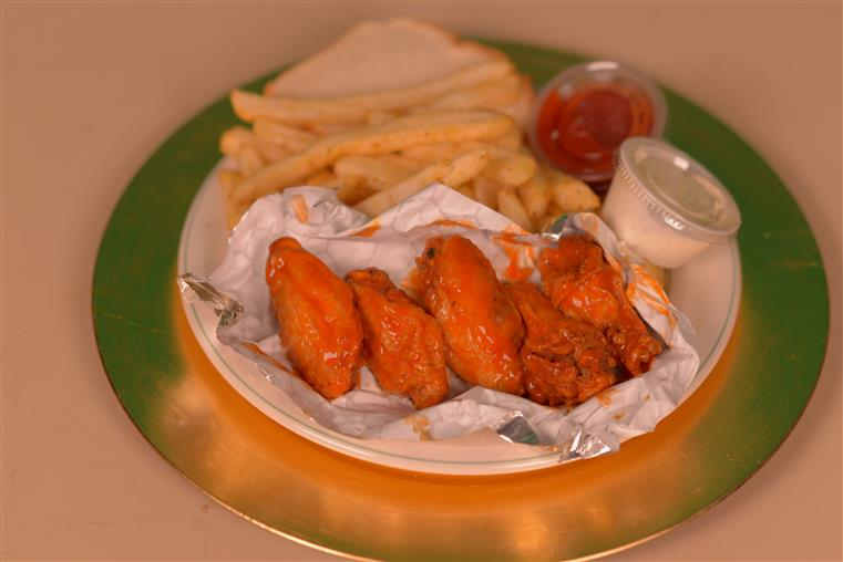 hot party wings and fries on plate
