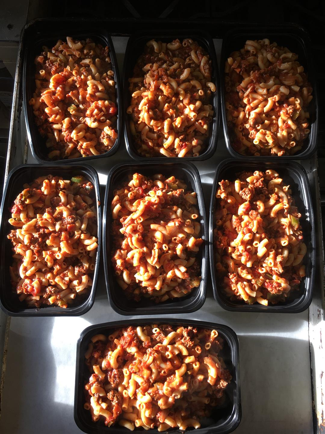 takeout containers of pasta with meat sauce