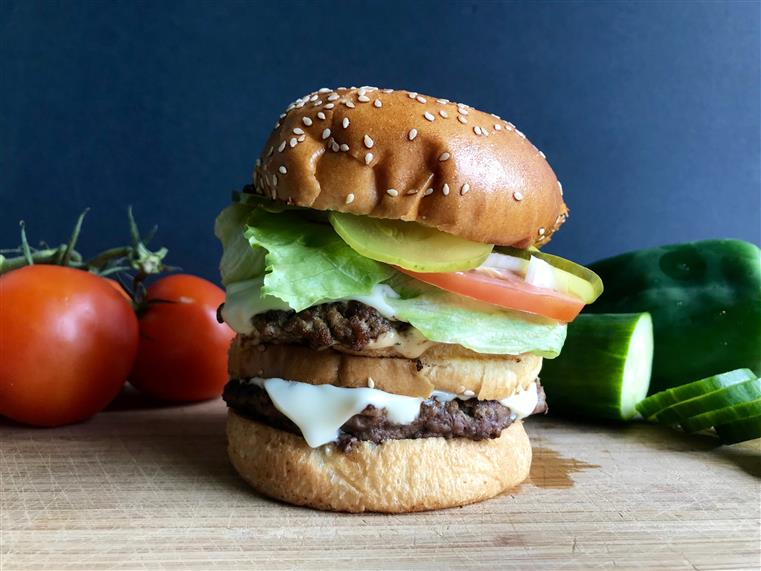 double cheeseburger with pickles, lettuce, and tomato