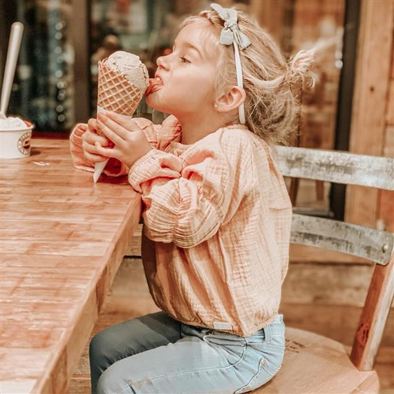 little girl licking her ice cream cone