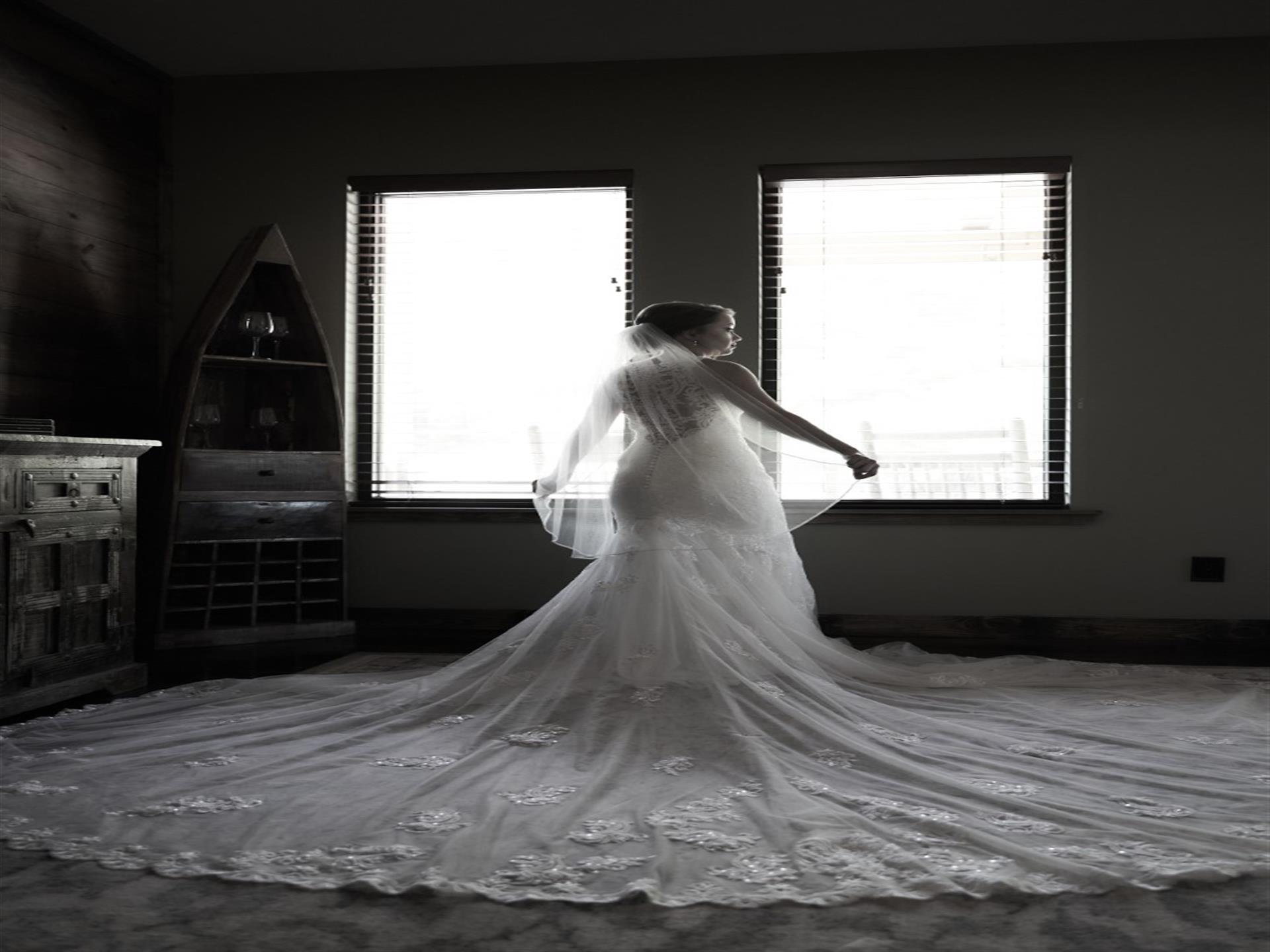 bride with her dress spreadout on the floor