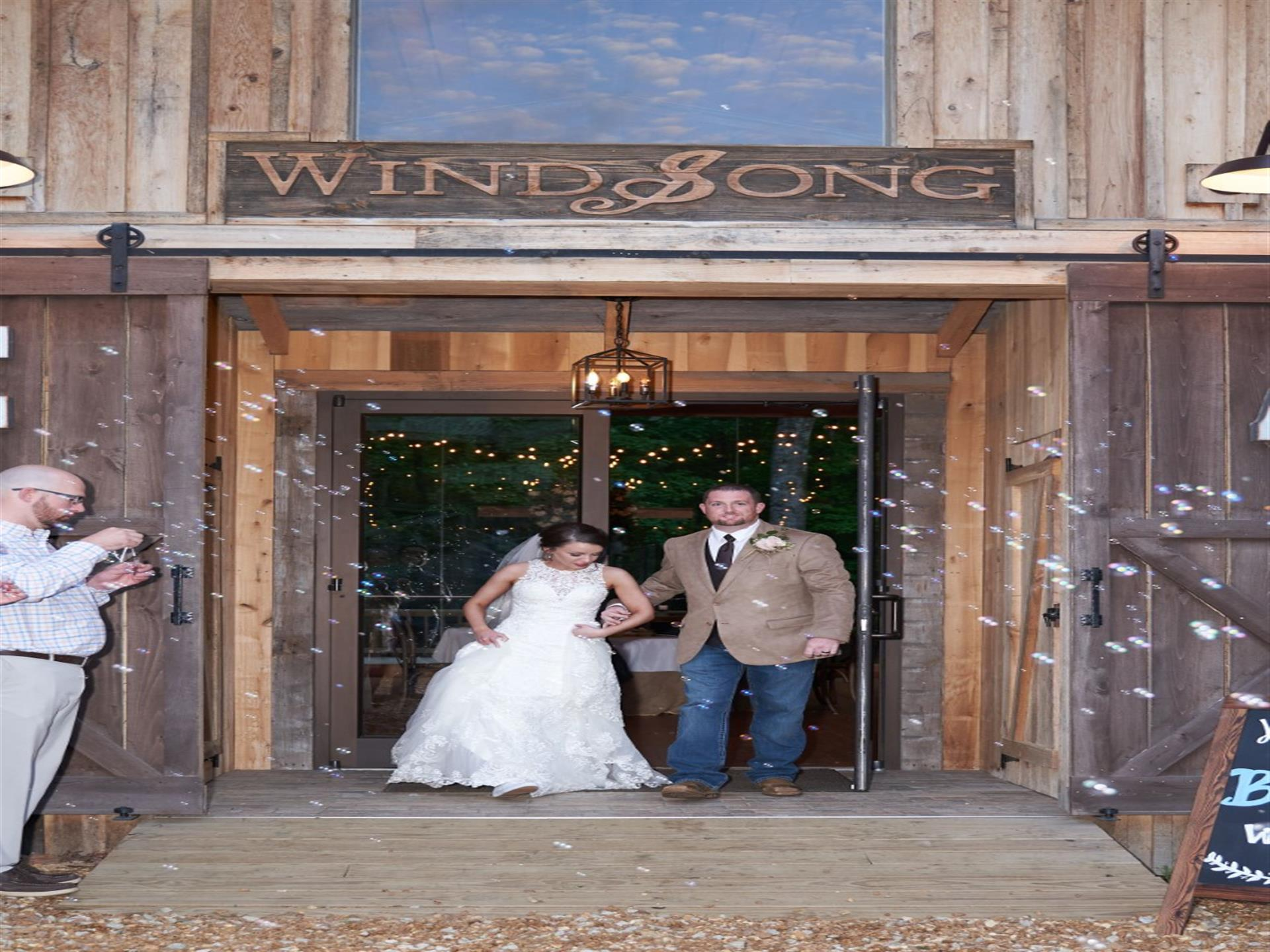bride and groom walking out of the windsong