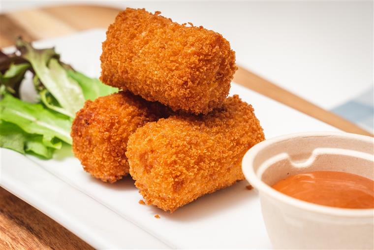 Manchego cheese croquetas with guava-truffle