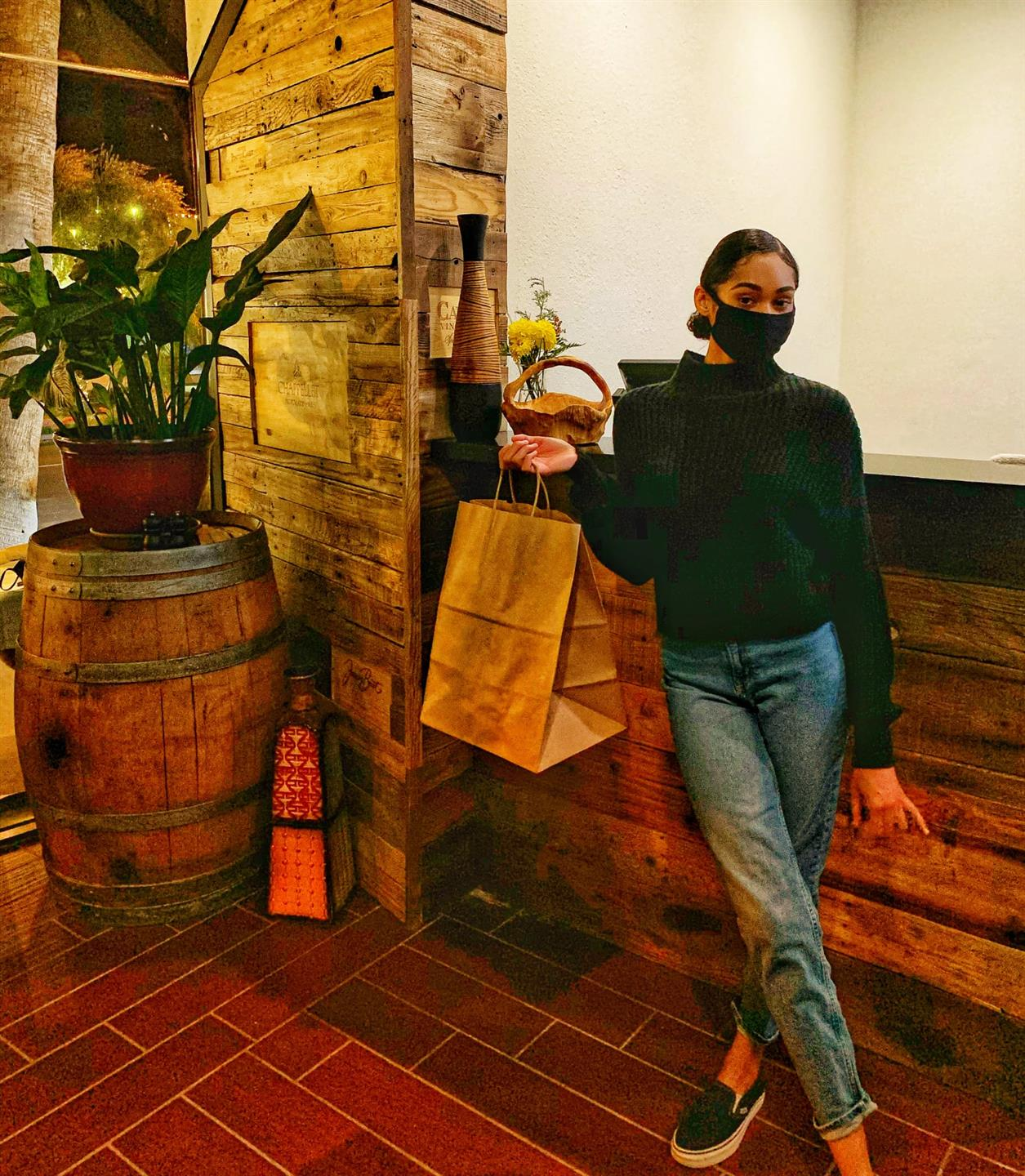 woman posing with a take-out bag