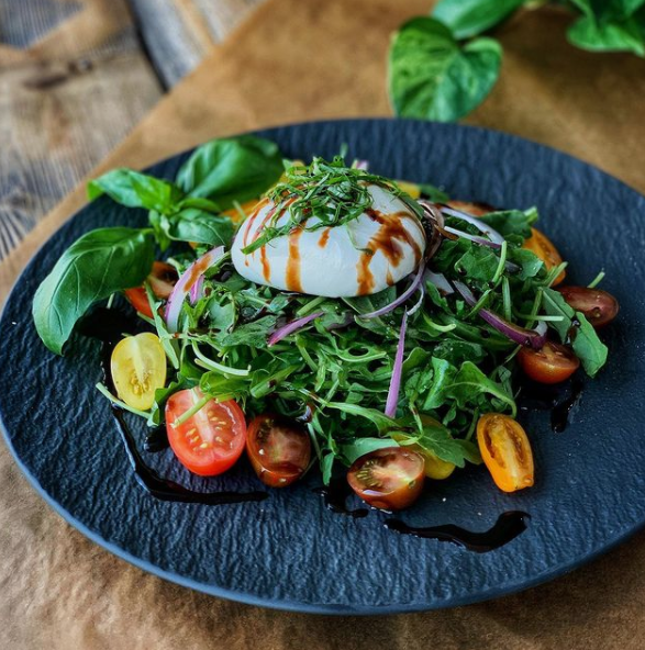 mixed greens and tomatoes topped with burrata