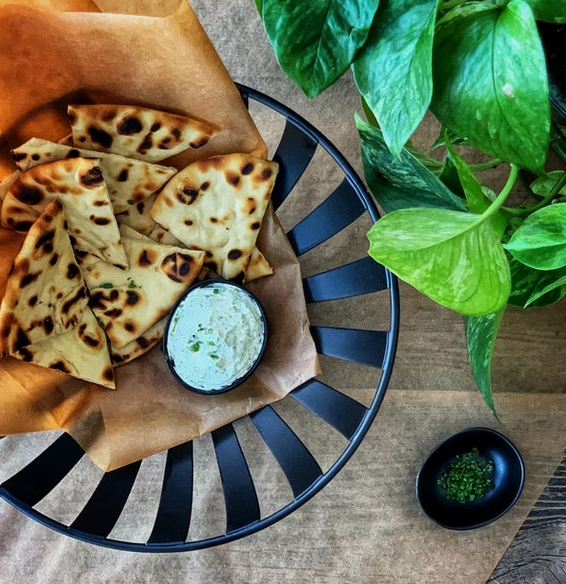 naan bread with a side of dipping sauce