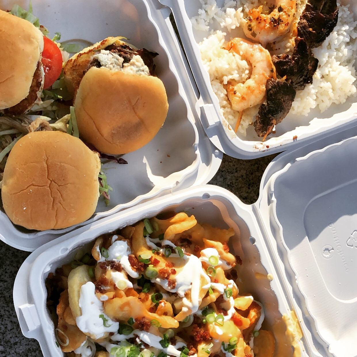 assortment of to-go containers filled with food