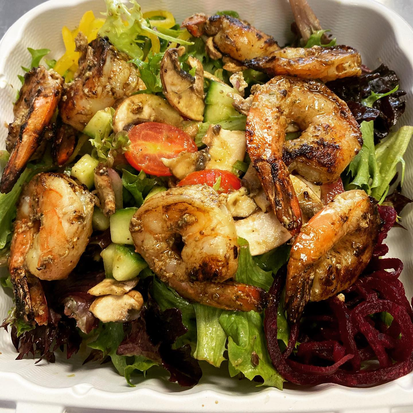 mixed greens topped with grilled shrimp and tomatoes