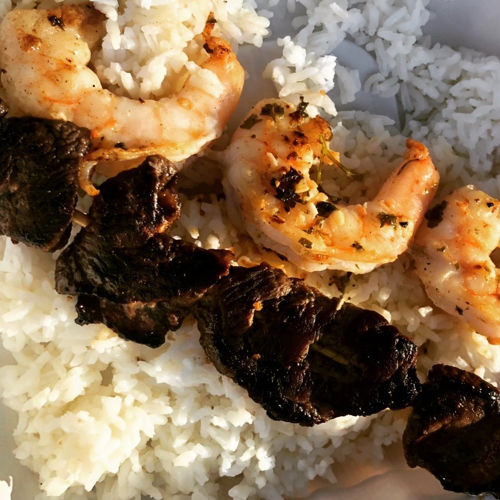 rice topped with shrimp and steak