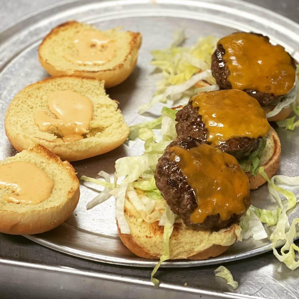 assortment of cheese sliders on a tray