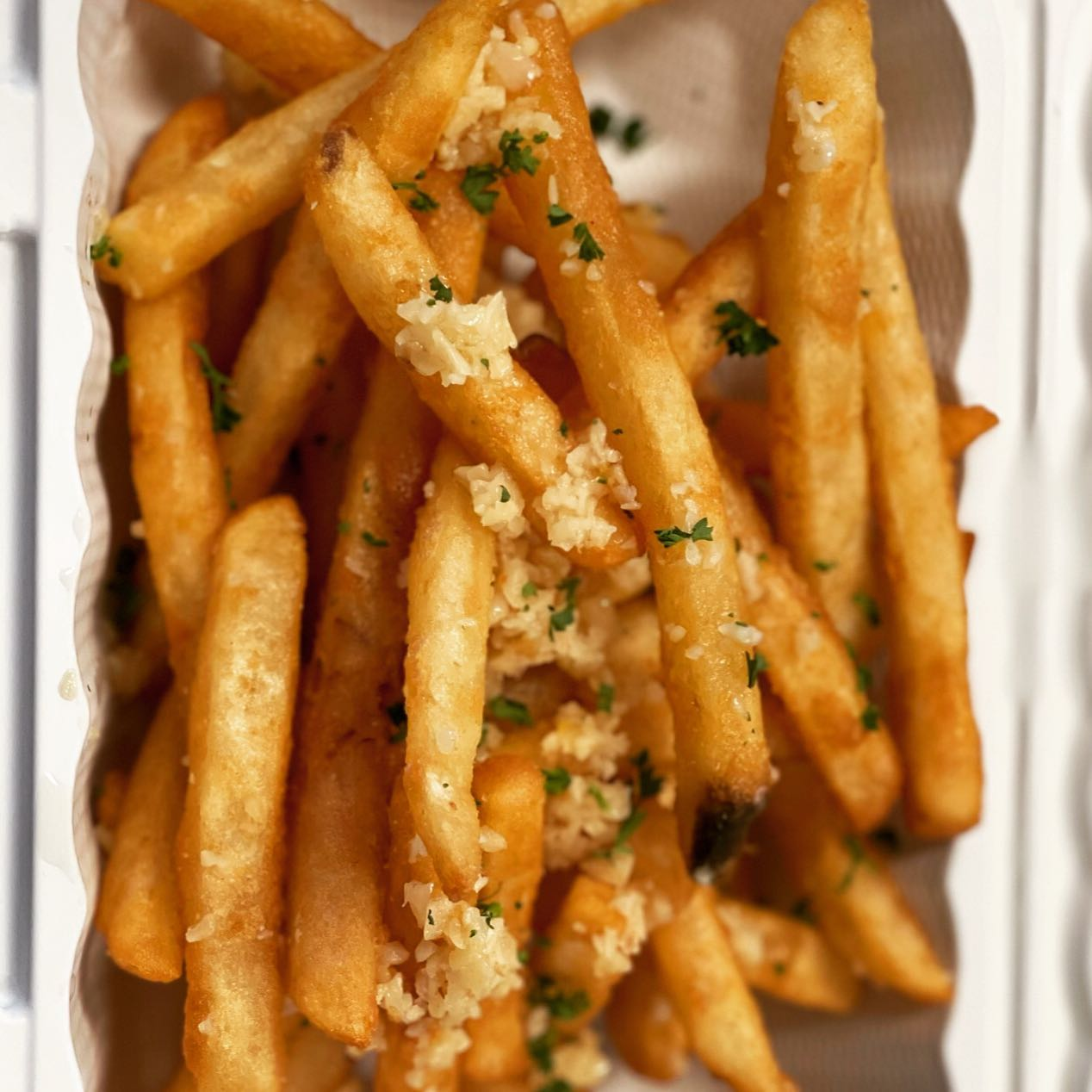 french fries topped with garnish