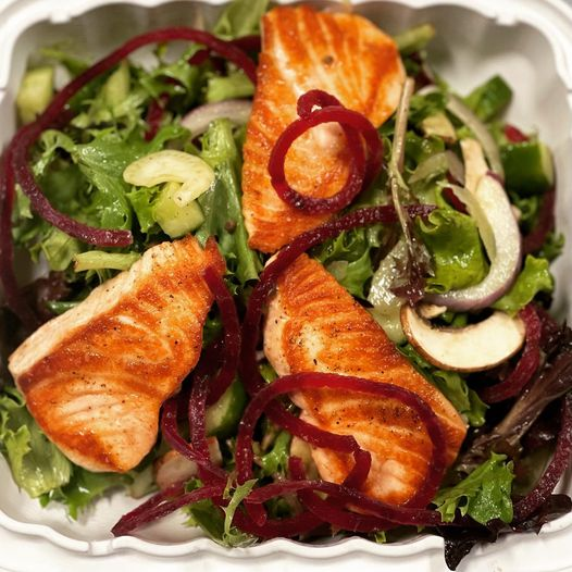 grilled salmon over mixed greens