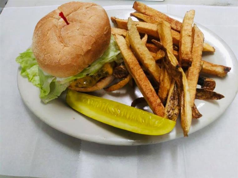 cheeseburger with lettuce, side of fries, pickle