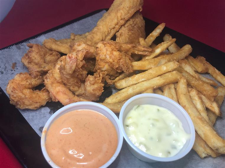 chicken fingers and fries with dipping sauces