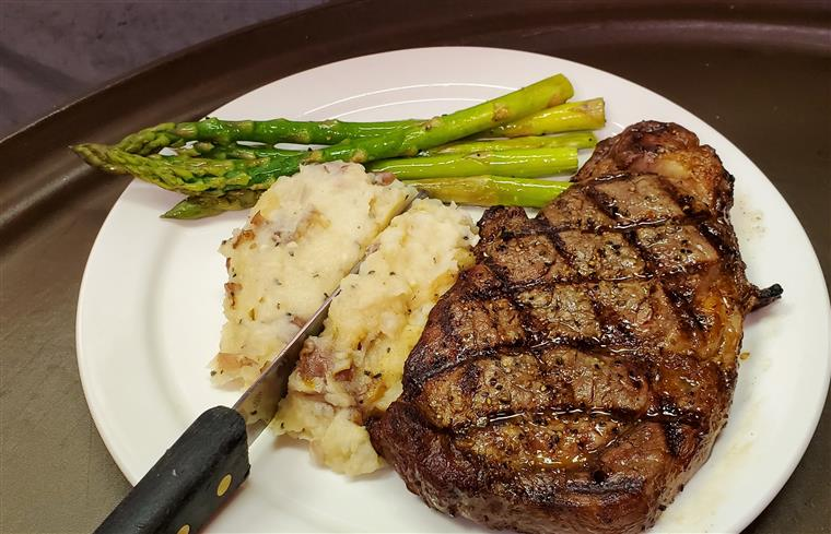 grilled steak with mashed potatoes and asparagus